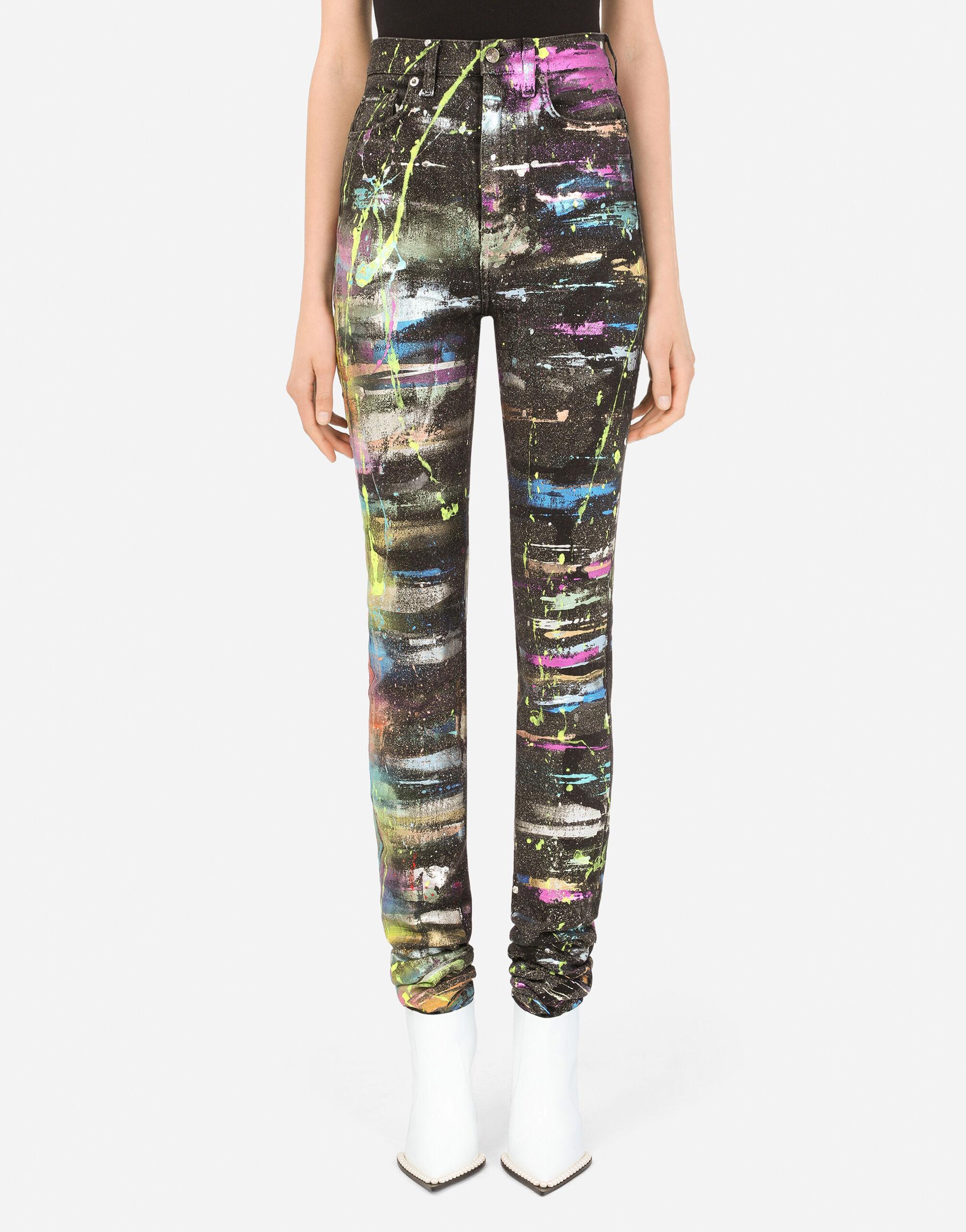 Jeans stampa dripping con drappeggio